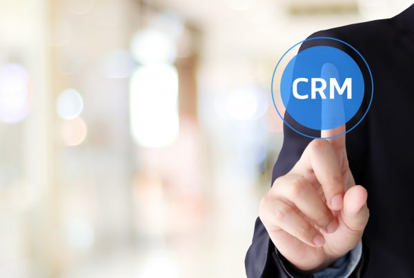 Businessman hand touch CRM, Customer Relationship Management, ic